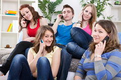 Teenagers with mobile phones Stock Image