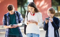 Teenagers with mobile phones Royalty Free Stock Photography