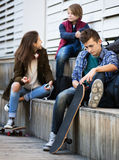 Teenagers with mobile phones Royalty Free Stock Image