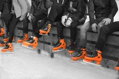 Teenagers in orange skate stock images