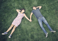 Teenagers outdoor. In the grass Royalty Free Stock Photography