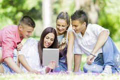 Teenagers in the park Royalty Free Stock Photo