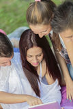 Teenagers in park with tablet Stock Images