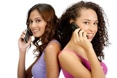 Teenagers with Phone. Two young teenagers with diverse ethnicities using their mobile phones against white background Stock Photography