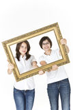 Teenagers with picture frame in front of them Royalty Free Stock Photography