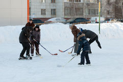 Teenagers play hockey on a domestic skating rink. Tyumen, Russia Royalty Free Stock Photo