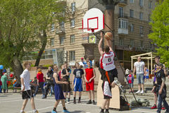Teenagers play streetball on the open-air asphalt ground Royalty Free Stock Images