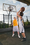 Teenagers playing basketball Royalty Free Stock Photo