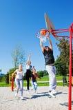 Teenagers playing basketball royalty free stock photography