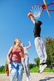 Teenagers playing basketball Stock Photo