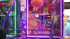 Teenagers playing basketball video game in game center. Moscow, Russia - March, 2016: Teenagers playing basketball video game in game center stock footage