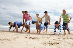 Teenagers playing on beach. Having fun royalty free stock photography