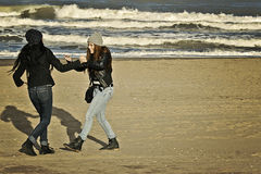 Teenagers  playing in the beach. Two teenagers playing in a beach of Mar del Plata, Argentina in a cold winter day Royalty Free Stock Images