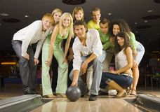 Teenagers playing bowling