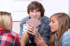 Teenagers playing cards Royalty Free Stock Photo