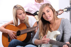 Teenagers playing the guitar. Together Royalty Free Stock Image
