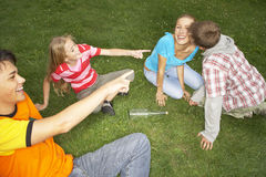 Teenagers playing in a park. stock images