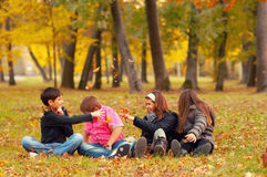 Teenagers playing in park in autumn Royalty Free Stock Images