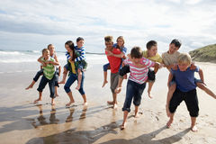 Teenagers playing piggyback. Having fun Stock Photos