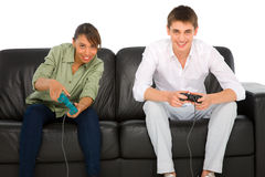 Teenagers playing with playstation. On white background Royalty Free Stock Photo