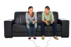 Teenagers playing with playstation Royalty Free Stock Images