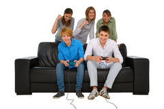 Teenagers playing with playstation Royalty Free Stock Image