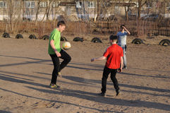 Teenagers playing soccer Royalty Free Stock Images