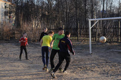 Teenagers playing soccer Royalty Free Stock Photos