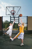 Teenagers playing streetball Stock Photo