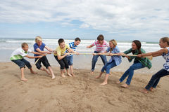 Teenagers playing tug of war. Having fun stock images