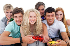 Teenagers playing video games Stock Images