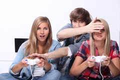 Teenagers playing video games Royalty Free Stock Photo