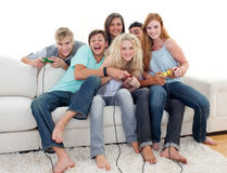 Teenagers playing video games at home Stock Image