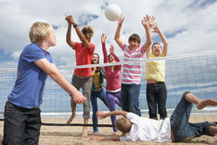 Teenagers playing volleyball. Having fun stock photography