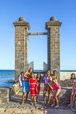 Teenagers posing at the entrance of the Castillo de San Gabriel in Arrecife, Lanzarote, Canary Islands Stock Photography