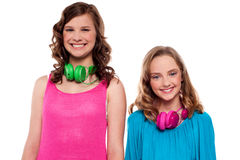 Teenagers posing with headphones around neck Stock Photography