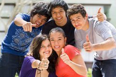 Teenagers posing outside school Stock Photo