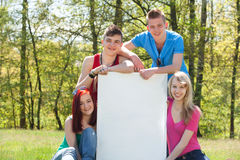 Teenagers presenting an empty copy space Royalty Free Stock Photo