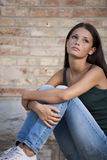 Teenagers problems. Teenage girls with problems, sitting outdoors Stock Images
