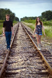Teenagers on railway tracks Royalty Free Stock Image