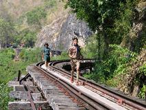 Teenagers on railway tracks Royalty Free Stock Photography