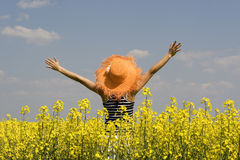 Teenagers in the rape field Royalty Free Stock Photography
