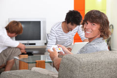 Teenagers relaxing at home Stock Images