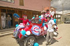 Teenagers riding a jeep decorated for the Fourth of July, in Lima Montana Royalty Free Stock Photography