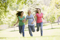 Teenagers Running Through Park Royalty Free Stock Photo
