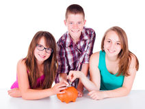 Teenagers saving money for the future Stock Photo