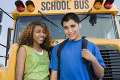 Teenagers By School Bus Stock Photo