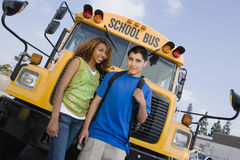 Teenagers By School Bus Stock Images