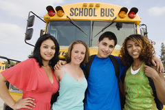 Teenagers By School Bus Royalty Free Stock Photography