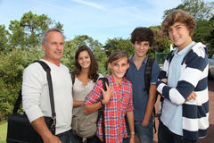 Teenagers at school with teacher royalty free stock photos